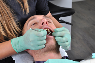 Man having tooth extracted