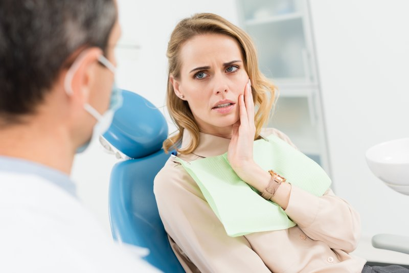 Patient with tooth pain talking to dentist